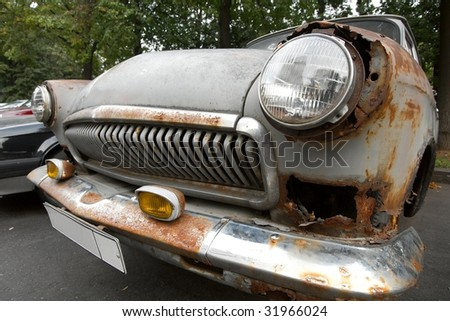 Old, rusty, wrecked car front - stock photo