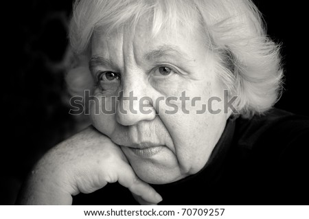 Old sad woman. - stock photo