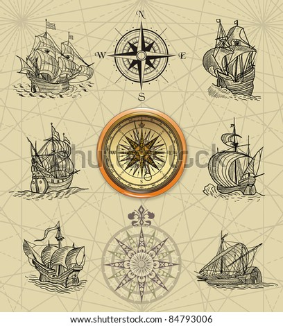Old sailboats and compass rose - stock photo