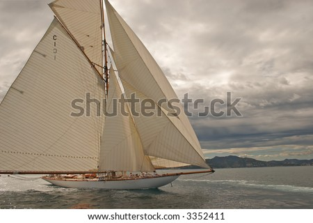 Old sailing boat all sails outside on the sea