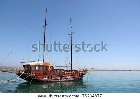 Old sailing boat on the ocean side