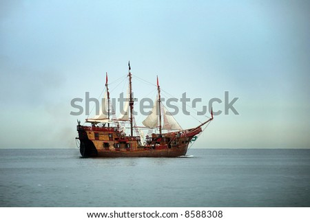 Old sailing ship in the ocean - stock photo