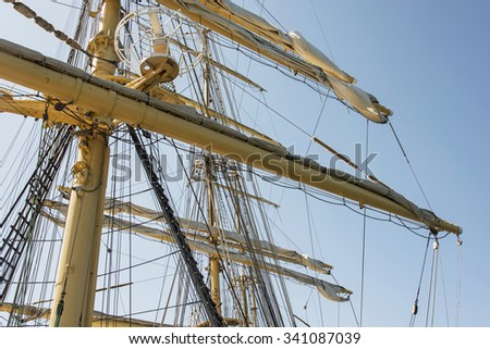 Old sailing ship masts sails and rigging - stock photo