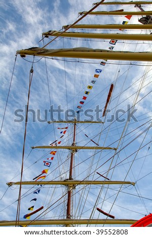 old sailing ship yard with marine flags - stock photo