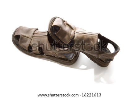 Old sandals with shadow on white background - stock photo