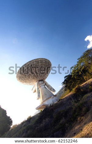 old satellite transmission earth-station - stock photo