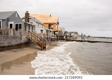 OLD SAYBROOK, CONNECTICUT September 12th: High tide from the full moon laps against the walls of a row of cottages  as waterfront construction continues on Sept. 12, 2014 in Old Saybrook, CT.  - stock photo