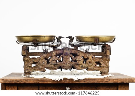 old scales standing on an old table - stock photo