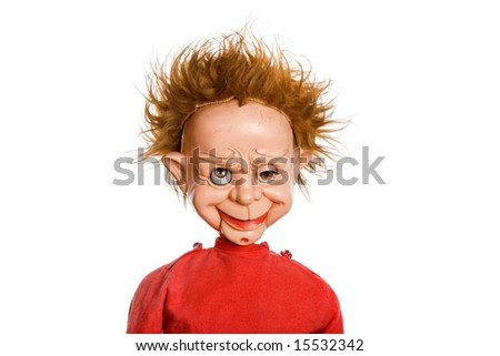 old scary male doll in a studio picture - stock photo