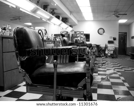 Old school barber shop with a checkerboard floor in black and white - stock photo