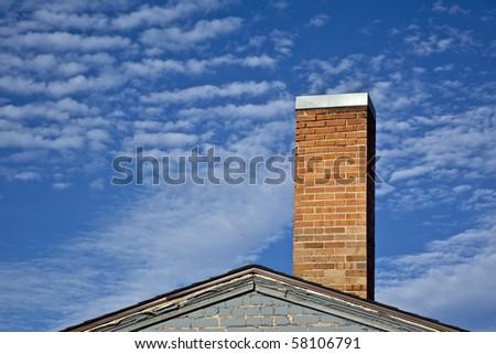 Old School Brick Chimeney on a Brick Out - stock photo