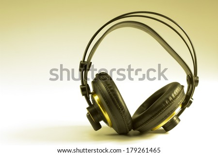 Old school headphone on gray background - stock photo