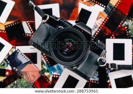 old school Photography,  film cameras with some negative film and slides - stock photo