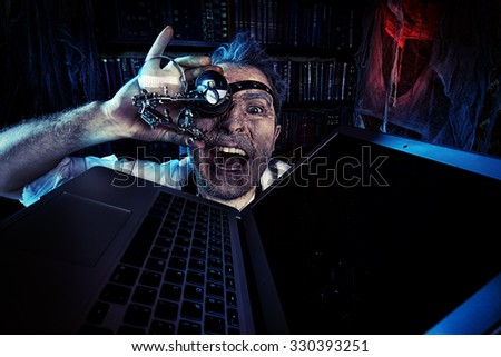 Old scientist working in his laboratory. Mixing eras. Halloween. - stock photo
