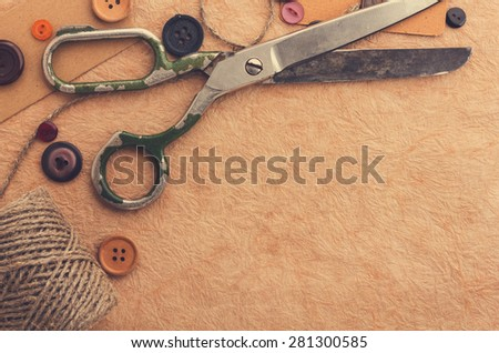 Old scissors on the paper texture - stock photo