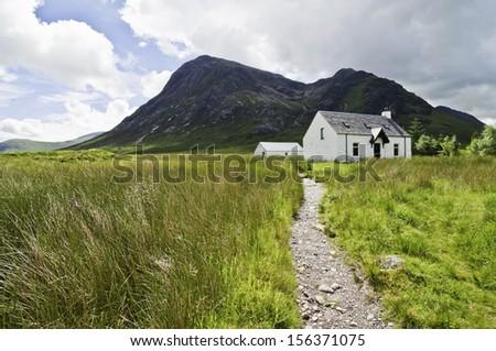 Old scottish cottage - stock photo
