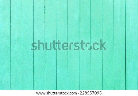 Old scratched and dirty wood painted green Wood plank texture background - stock photo