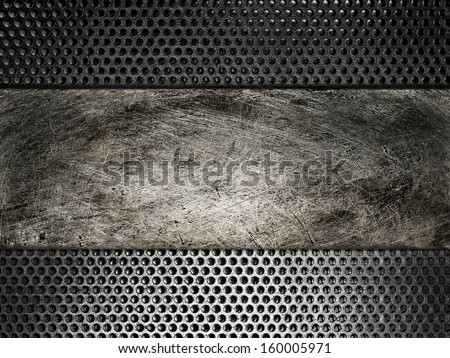 Old scratched metal plate on the background grid - stock photo