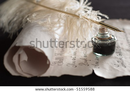 Old scroll paper,ink and quill pen in focus - stock photo