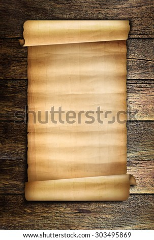 Old scroll paper on wood plank
