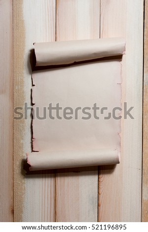 Old scroll paper with empty space for text on vertical wooden boards. Background in grunge style.