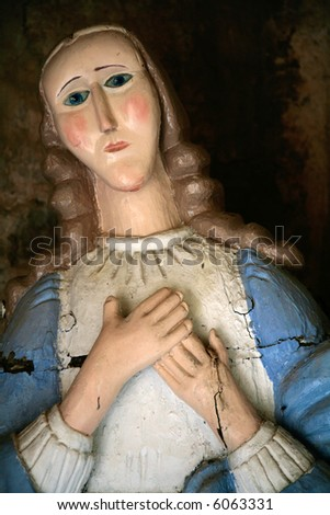 old sculpture of virgin Mary - stock photo