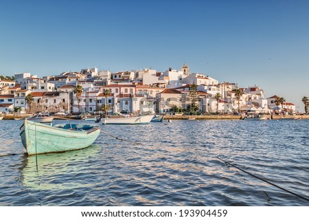 Old sea town of Ferragudo. With the boat in the foreground. - stock photo