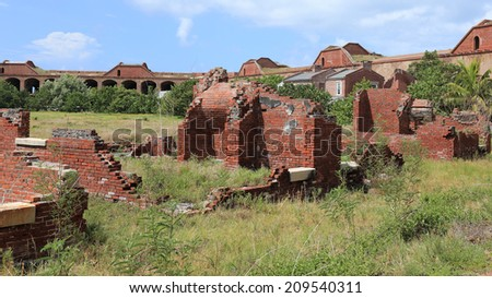 Old sections of Fort Jefferson lie in ruins within the fort's massive courtyard. - stock photo