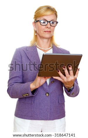 Old senior business woman 60-65 years in glasses and suit, using digital tablet pc computer reading ebook. Isolated on white background - stock photo