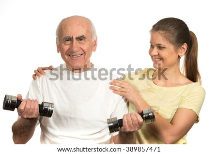 old senior man and young woman happy and  doing sport - stock photo