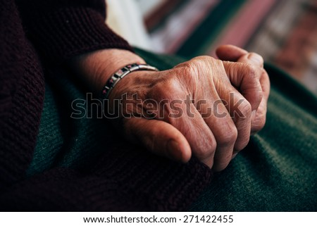 Old senior woman hands wrinkled skin - stock photo