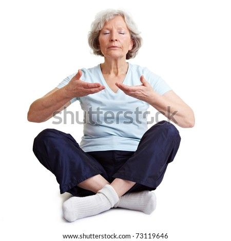 Old senior woman meditating and relaxing with breathing exercises - stock photo
