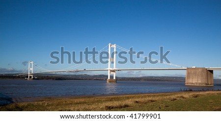 Old Severn Bridge connecting Wales and England across the Severn Estuary carrying  M48 motorway - stock photo