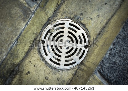 Old sewer grate drain water - stock photo