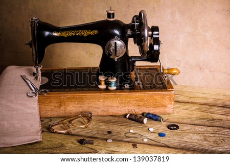 Old sewing machine. - stock photo