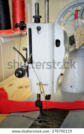 old sewing machine in the sewing studio . side view, close up, vertical - stock photo