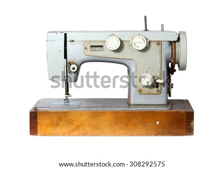 Old sewing machine isolated on white - stock photo