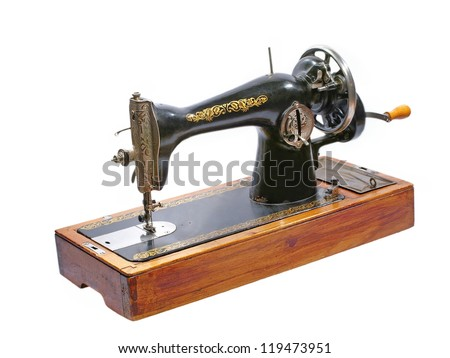 Old sewing machine isolated on white background.