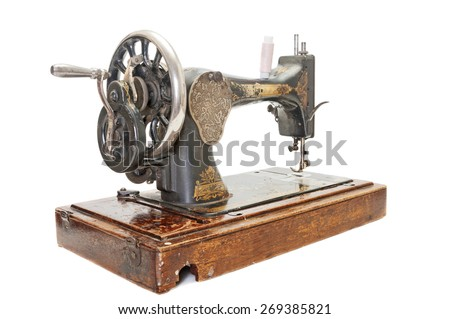 Old sewing machine on white background - stock photo