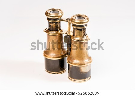 Old shabby binoculars on a white background, isolated