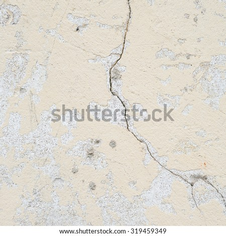 Old shabby concrete painted yellow wall as an abstract background texture - stock photo