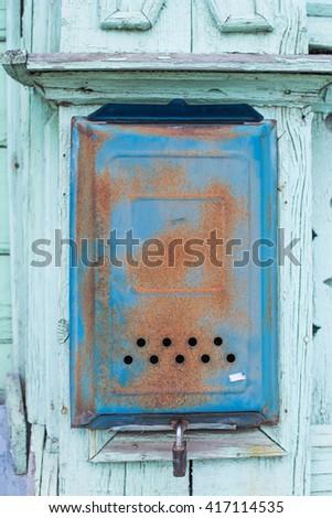 Old shabby rusty mailbox - stock photo