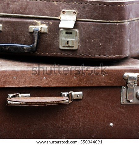 old shabby suitcase made of genuine leather