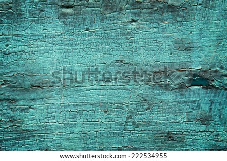 Old shabby wooden door painted with cracked color background - stock photo