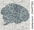 Old shattered hand drawn image of floral patterns shaping a human brain - stock