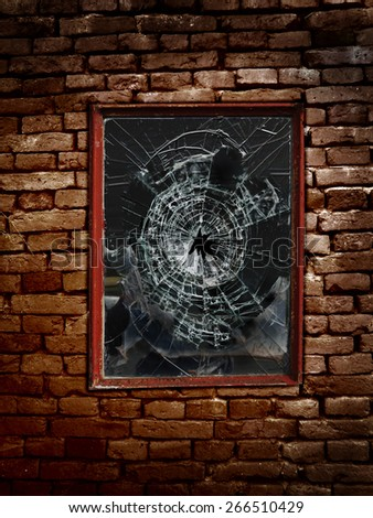 Old shattered window and brick wall                                - stock photo