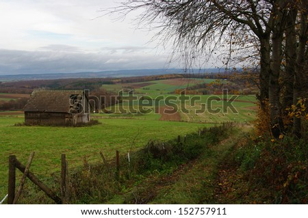 Old Shed in Autumn Landscape