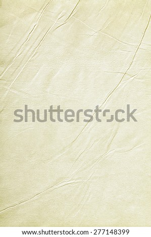 Old sheet of paper folded and battered, with paper texture.  - stock photo