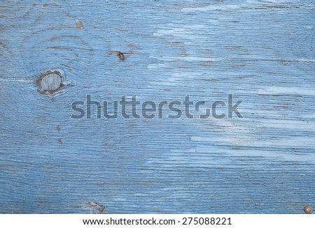 old sheet of plywood painted in blue color - stock photo