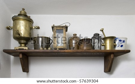 old shelf with a different vintage crockery - stock photo